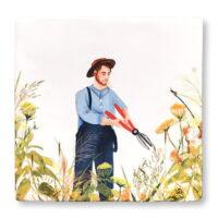 tuinier snoeit bloementuin